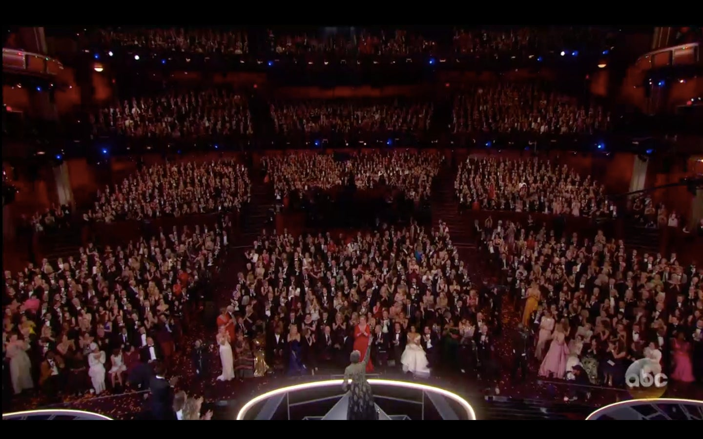 All the nominated women in the auditorium standing.