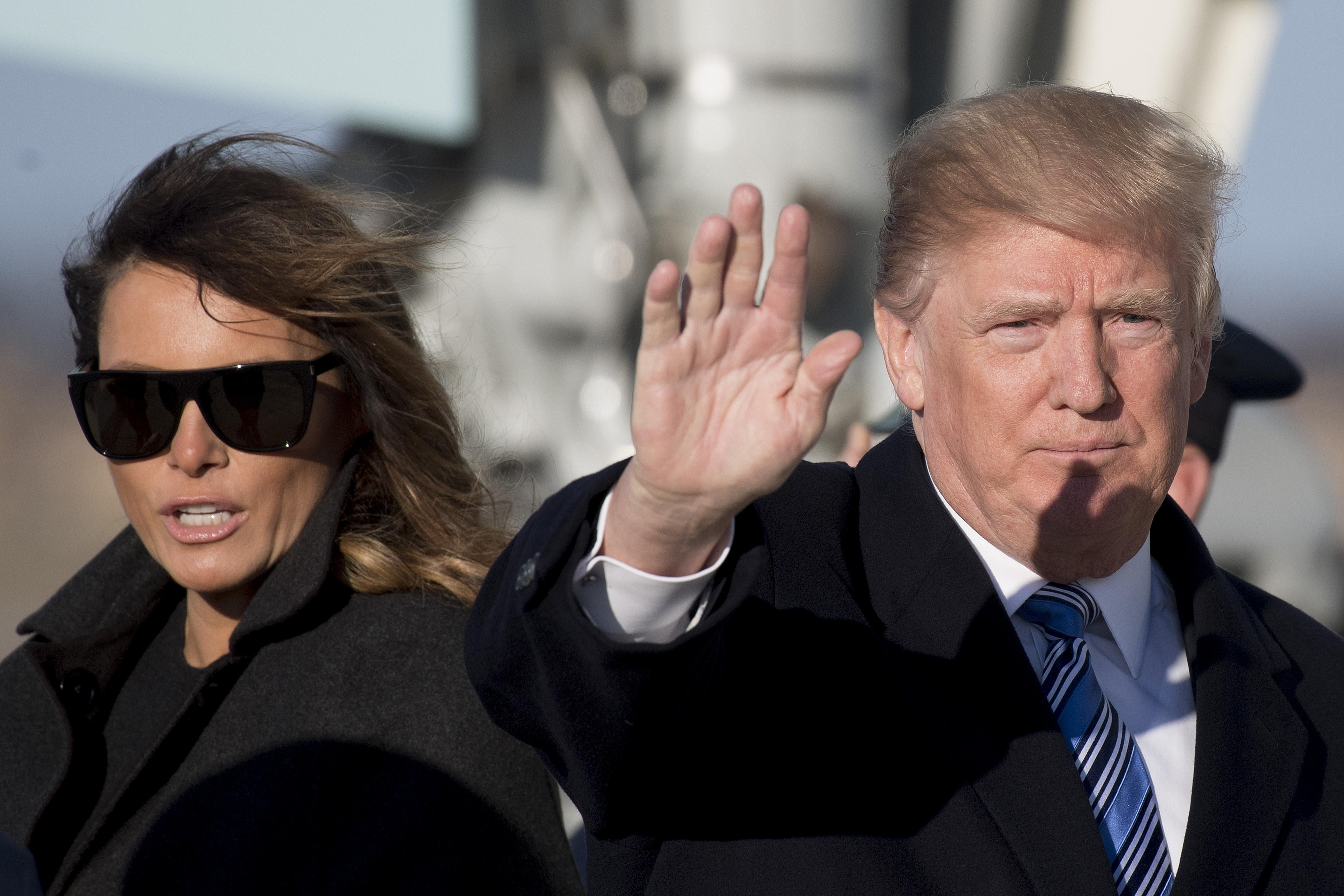 President Trump and First Lady Melania Trump walk off Air Force One at Andrews Air Force Base, Maryland, on Sunday.