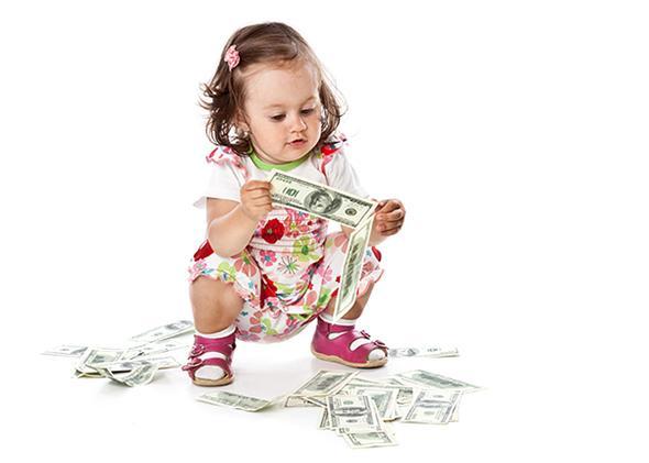 Child plays with $100 bills.