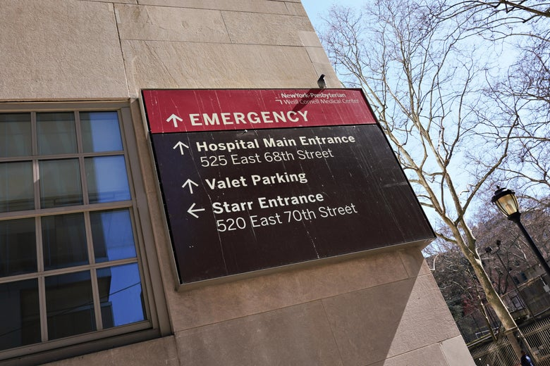 A sign outside NewYork-Presbyterian Hospital pointing to the emergency room.