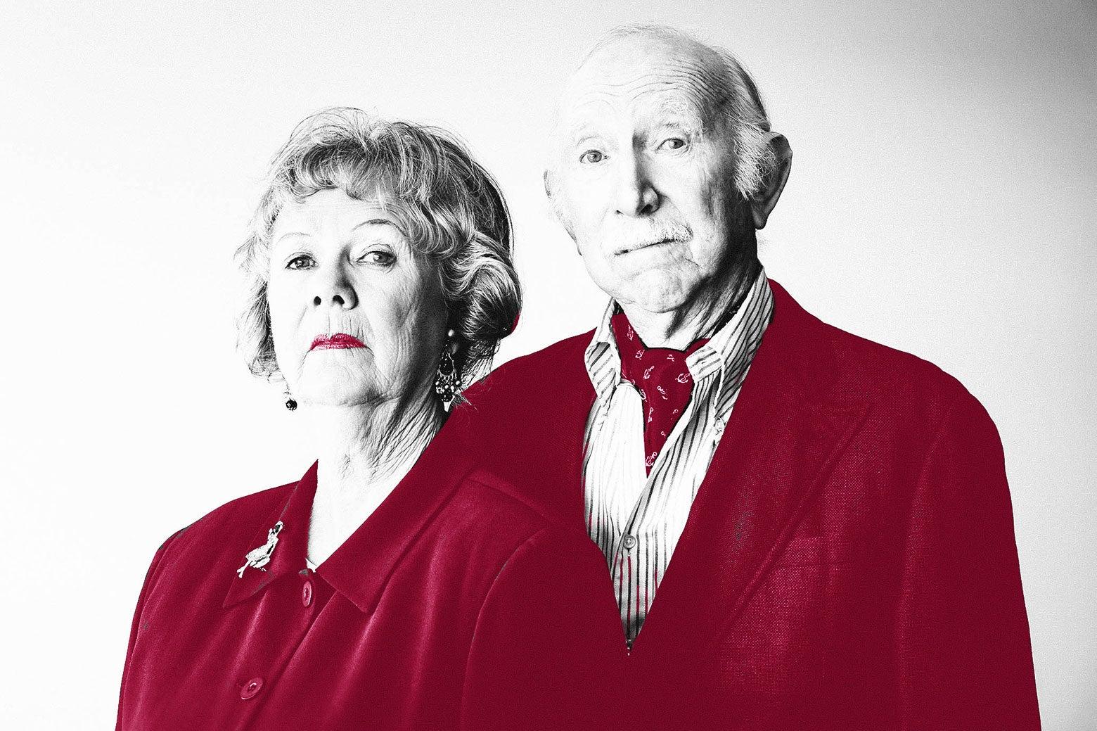 Stern-looking elderly parents.