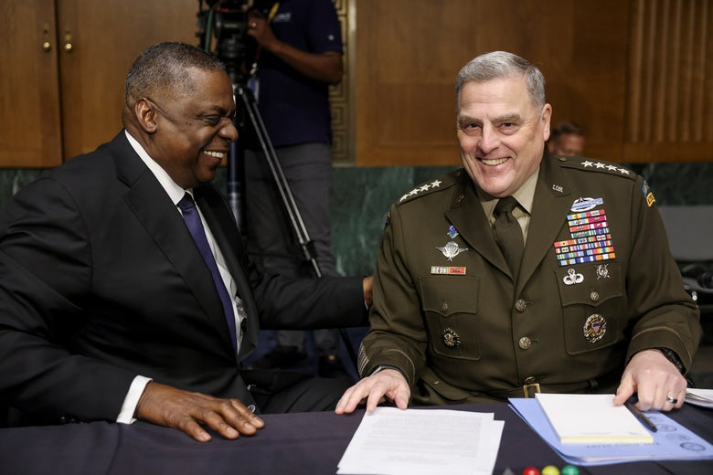 U.S. Defense Secretary Lloyd Austin laughs with Joint Chiefs of Staff Chair Gen. Mark Milley during a break in a Senate Appropriations Committee hearing on the defense department's budget on Capitol Hill in Washington, U.S., June 17, 2021.
