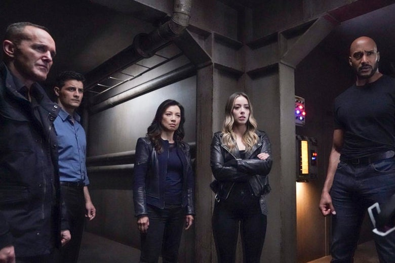 In a still from the show, Clark Gregg, Enver Gjokaj, Ming-Na Wen, Chloe Bennet, and Henry Simmons stand next to one another