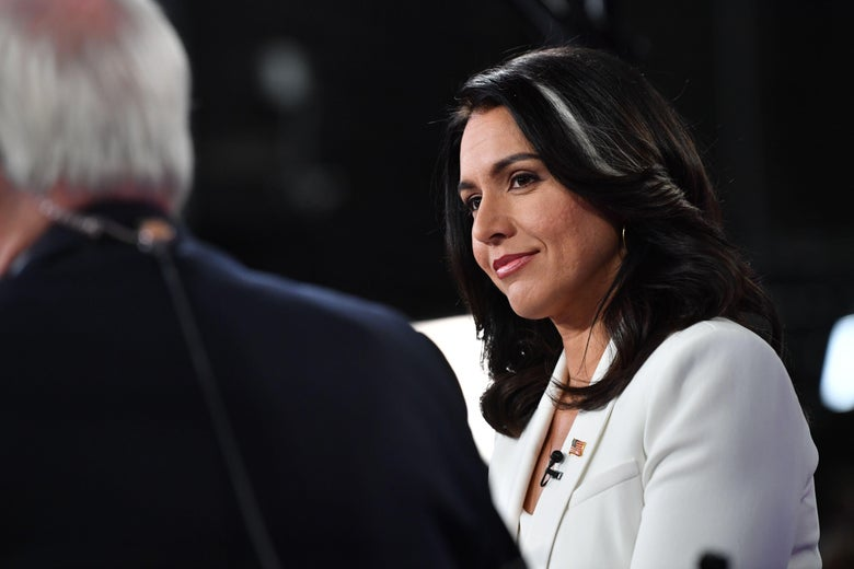 Gabbard tilts her head, smiling.
