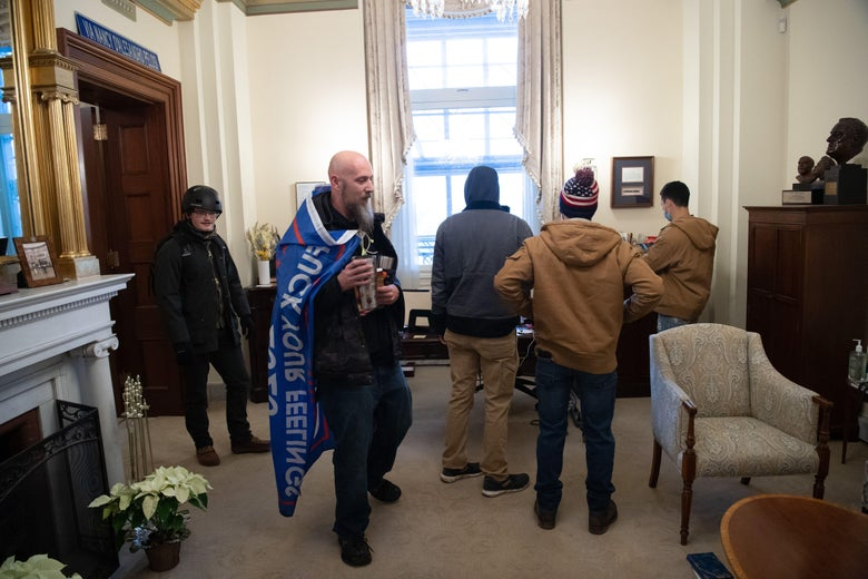 Rioters are seen in the office suite of House Speaker Nancy Pelosi after breaching the Capitol in Washington, D.C. on January 6, 2021.