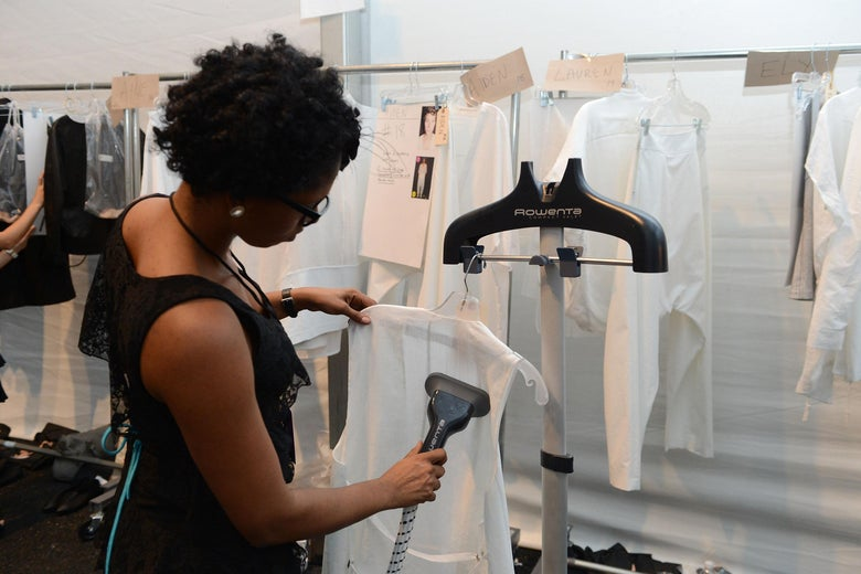 A stylist uses a Rowenta steamer during Spring 2013 Mercedes-Benz Fashion Week at Lincoln Center for the Performing Arts on September 7, 2012 in New York City.