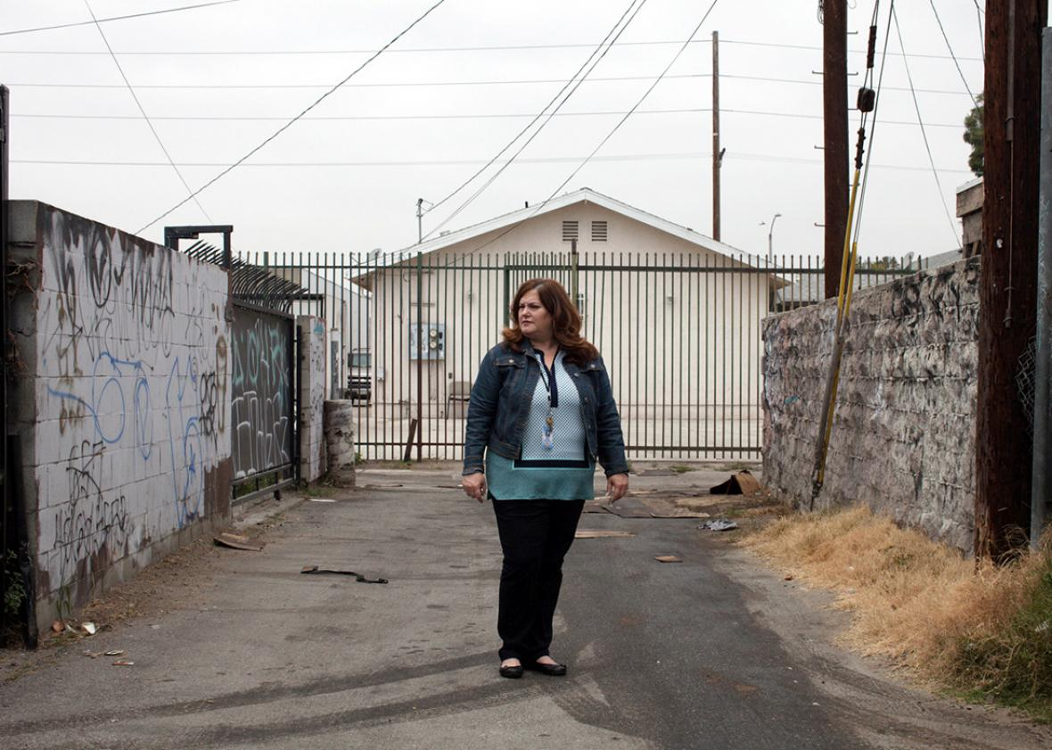 Davis in am alley near her childhood home in South Central L.A.