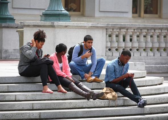 Students hang out on the steps of Sproul Hall at UC–Berkeley.