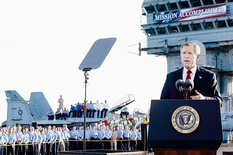 "George W. Bush on an air craft carrier in front of the notorious ""Mission Accomplished"" sign."
