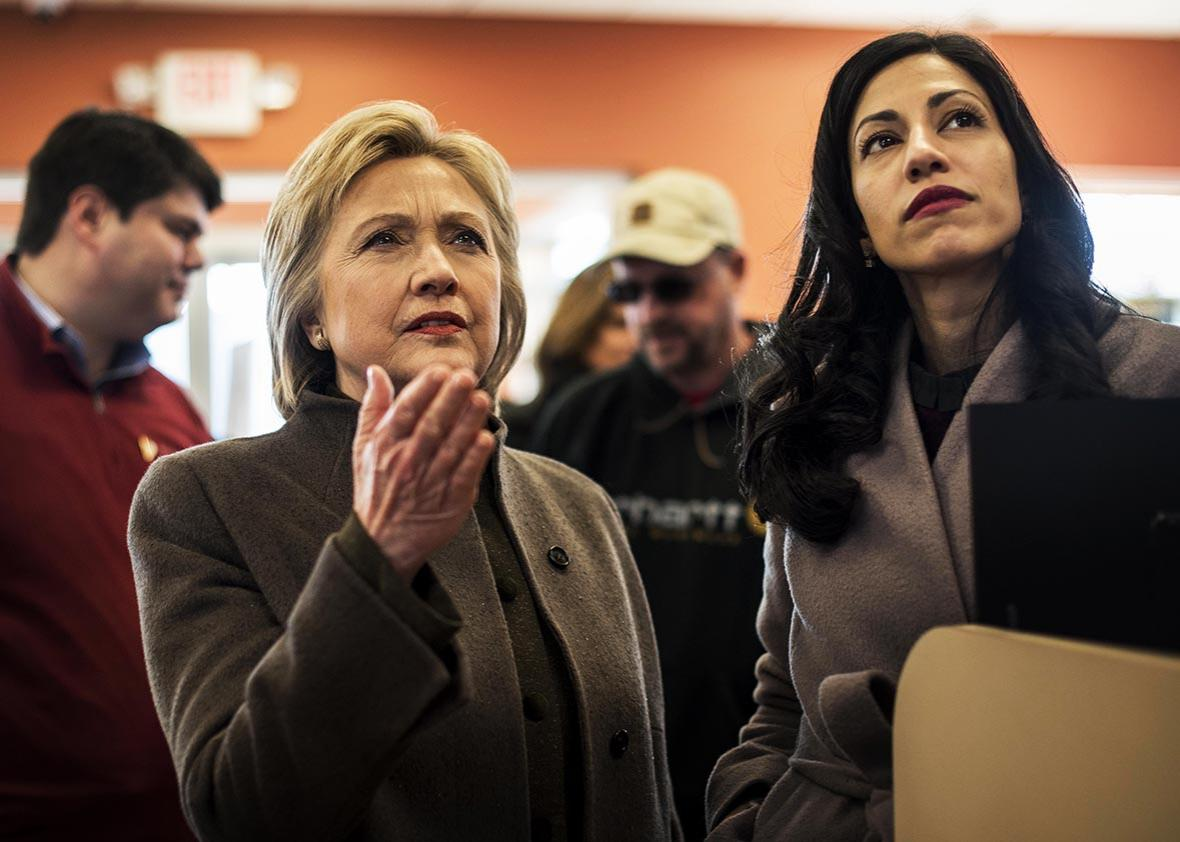 Meeting voters and picking up food for the road, former Secretary of State Hillary Clinton, accompanied by Senior Staffer Huma Abedin, stops at a Dunkin' Donuts in Manchester, New Hampshire on Sunday, February 7, 2016.