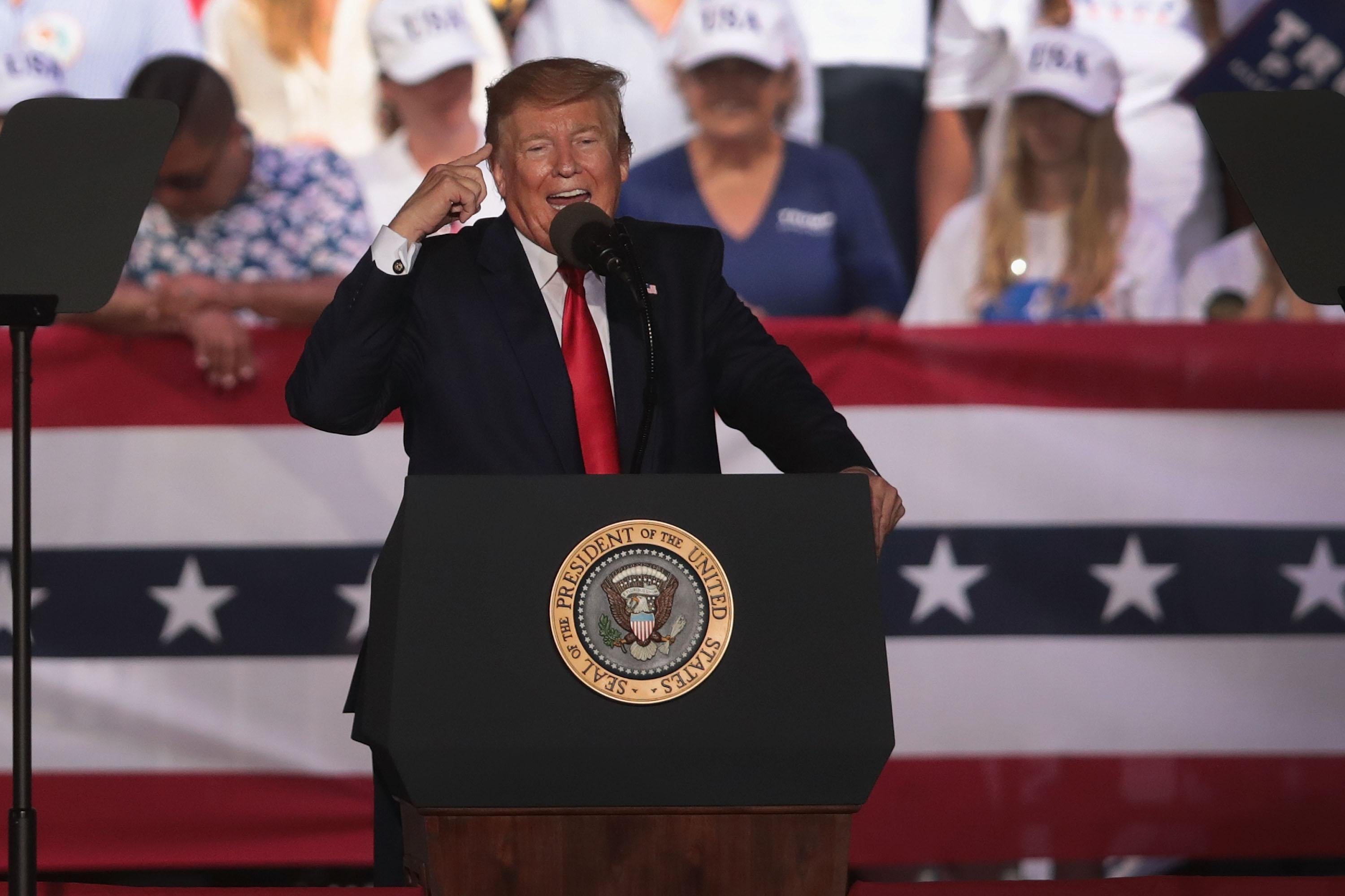 Trump speaks at a podium at a rally.