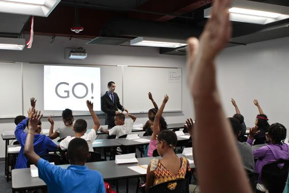 Math teacher Robert Biemesderfer asks students questions during the opening of a BASIS charter school, a brand that has been called one of the most challenging high schools in the country.