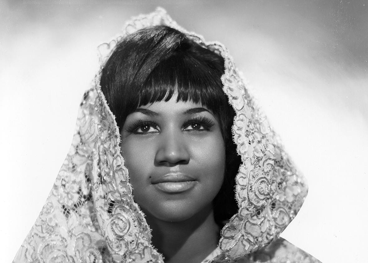 Soul singer Aretha Franklin poses for a portrait wearing a shroud in circa 1967.