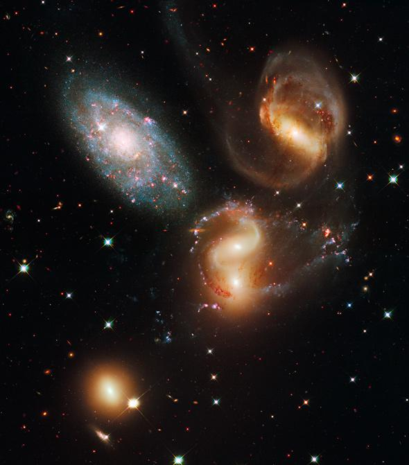 Three of the galaxies in this famous grouping, Stephan's Quintet, are distorted from their gravitational interactions with one another. One member of the group, NGC 7320 (upper left) is actually seven times closer to Earth than the rest.