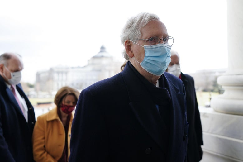 McConnell, wearing a blue mask, at the Capitol after the inauguration ceremony.
