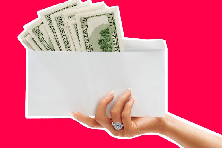 Hand wearing a large engagement ring holding an envelope full of cash.