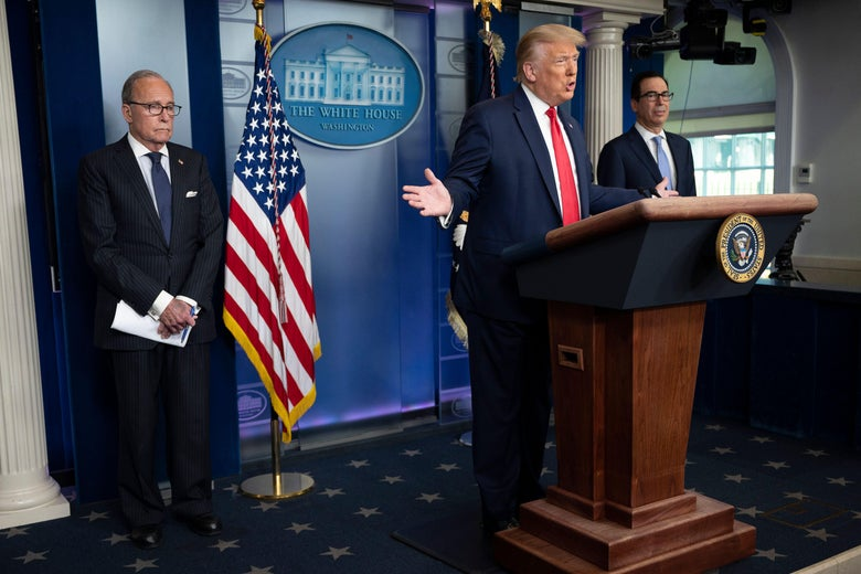 Donald Trump at the podium in the White House briefing room with his arms spread wide. Kudlow and Mnuchin stand at either side of him.