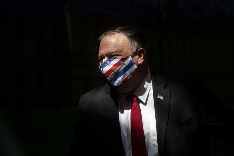 Pompeo wearing a stars-and-stripes mask against a black background.