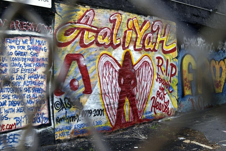 A memorial mural to Aaliyah is seen through a fence.