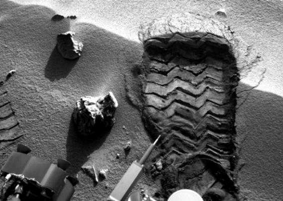 "NASA's Mars rover Curiosity cut a wheel scuff mark into a wind-formed ripple at the ""Rocknest"" site to give researchers a better opportunity to examine the particle-size distribution of the material forming the ripple, on the mission's 57th Martian day, or sol (Oct. 3, 2012)."