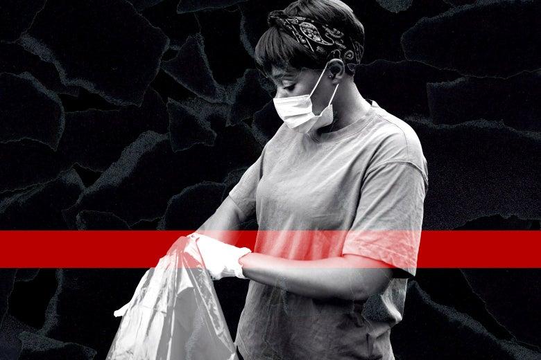 A Black woman in a mask puts trash in a bag.