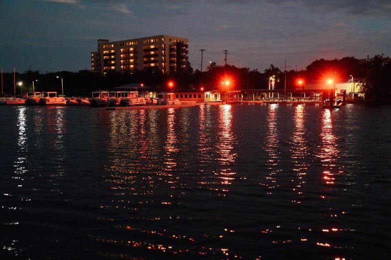 Lights shine from a marina at the U.S. Naval Station at Guantanamo Bay on Oct. 23, 2016.