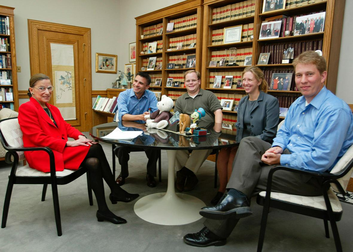 Justice Ruth Bader Ginsburg sits in her chambers at the Supreme Court with her clerks on Aug. 7, 2002, in Washington, D.C.