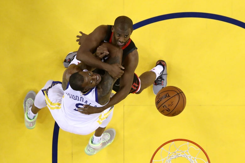 Andre Iguodala and Chris Paul battle for a rebound.