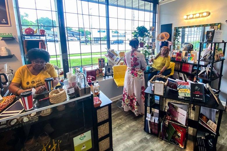Three women in a coffee shop/bookstore.