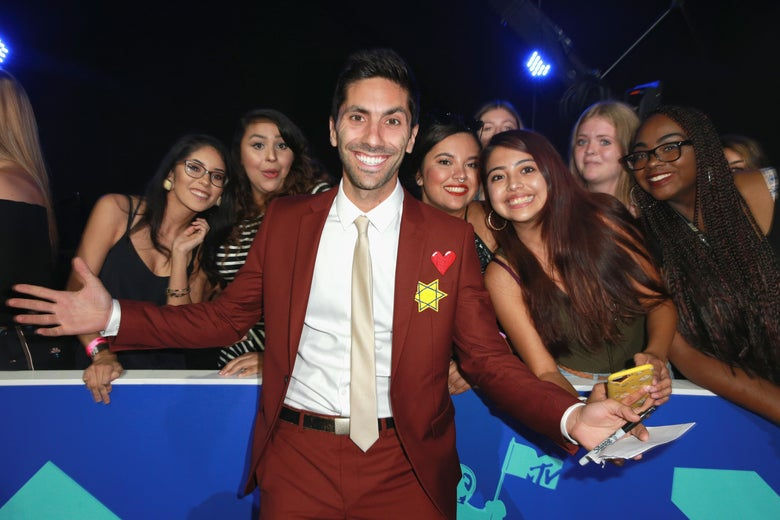 Nev Schulman poses with fans at the 2017 MTV Video Music Awards at The Forum on August 27, 2017 in Inglewood, California.
