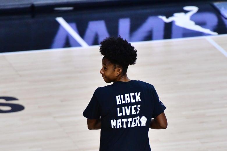 Shenise Johnson is seen on a basketball court wearing a Black Lives Matter shirt.