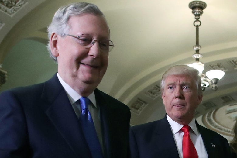 Donald Trump looks at a smiling Mitch McConnell.