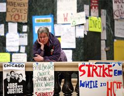 A protestor looks over a railing while standing inside the Wisconsin State Capitol