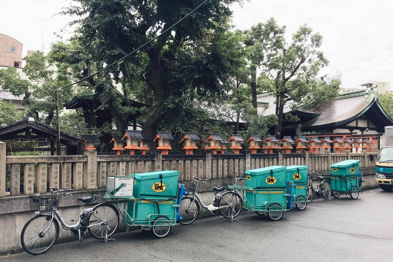 A row of bikes on a city street in Japan