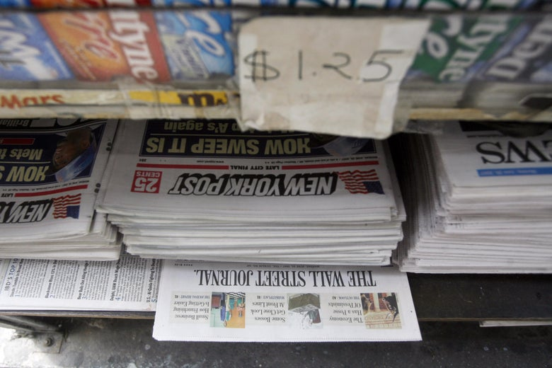Copies of the New York Post sit on display at a newsstand.