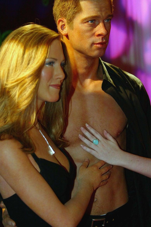 Dead-eyed wax sculptures of Brad Pitt and Jennifer Aniston.