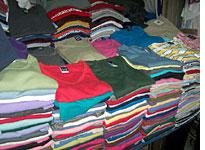 Neat piles of shirts with familiar labels