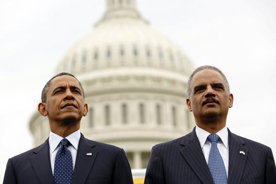 U.S. President Barack Obama and Attorney General Eric Holder attend the National Peace Officers Memorial Service at the Capitol in Washington May 15, 2013.