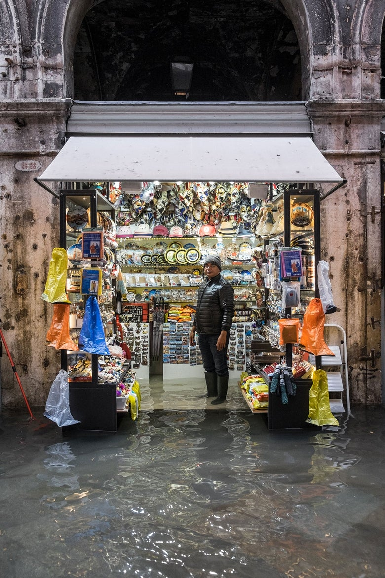 A shop owner portrayed inside his souvenir shop near Rialto Bridge, Venice, Nov 15th 2019.
