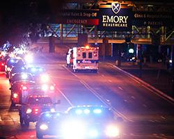 Ebola patient Amber Vinson arrives by ambulance at Emory University Hospital on Oct. 15, 2014, in Atlanta