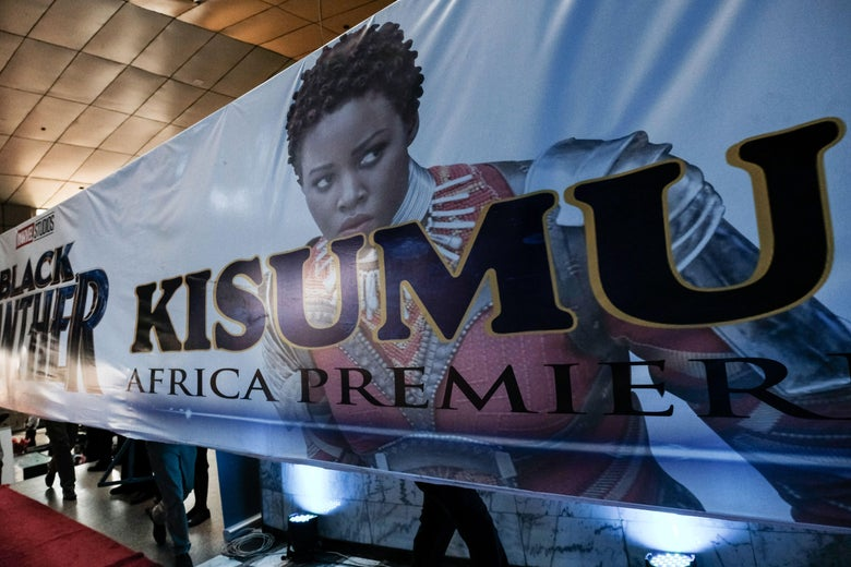 Men carry a banner with an image of Kenyan actress Lupita Nyong'o before the African premier of the Marvel film 'Black Panther' in Kisumu, Kenya, on February 13, 2018.