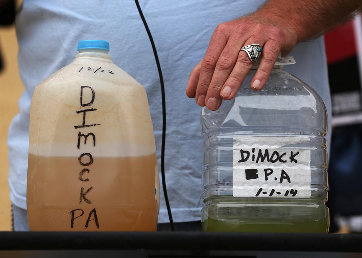 Ray Kemble of Dimock, Pennsylvania, show water samples collected from Dimock, Pennsylvania during a rally on fracking-related water investigations October 10, 2014 outside EPAs Headquarters in Washington, DC.
