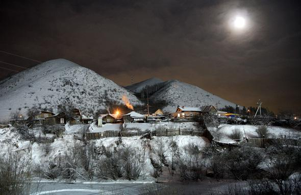 The moon shines above the Siberian village of Bazaikha near Krasnoyarsk January 2, 2007.
