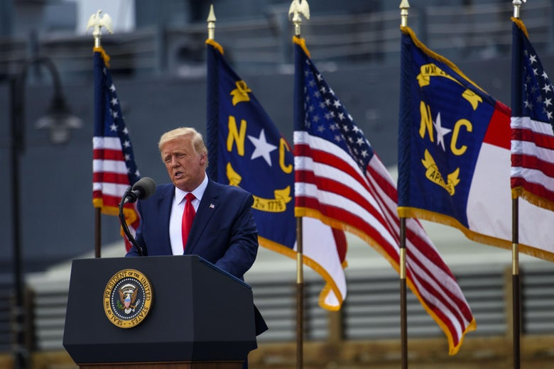 President Donald Trump speaks to a small crowd outside the USS North Carolina in Wilmington.