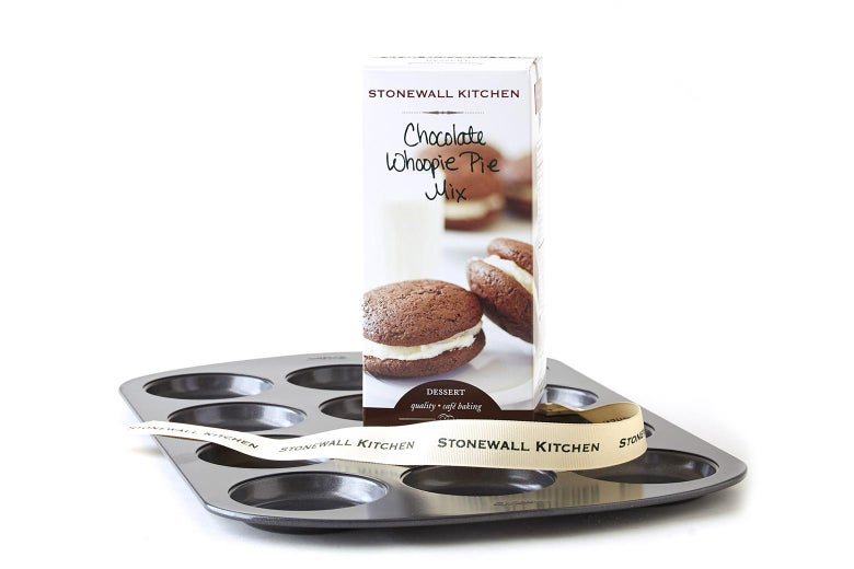Whoopie pie pan with box of whoopie pie mix and Stonewall Kitchen ribbon set on top of it