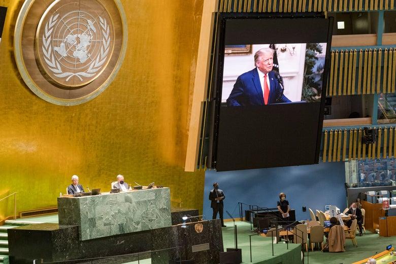Trump is seen on a screen inside the U.N. headquarters.