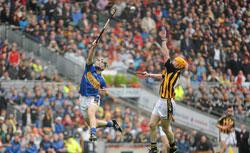 A pair of hurlers in action. Click image to expand.