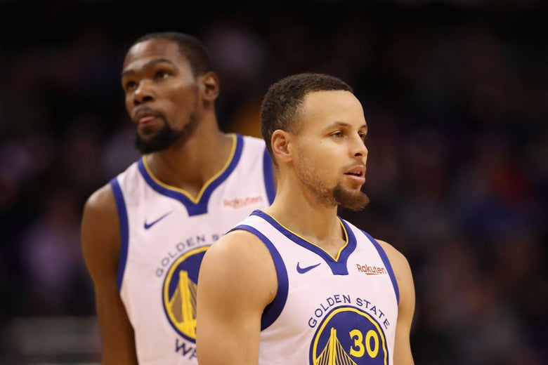PHOENIX, ARIZONA - FEBRUARY 08:  Stephen Curry #30 and Kevin Durant #35 of the Golden State Warriors during the first half of the NBA game against the Phoenix Suns at Talking Stick Resort Arena on February 08, 2019 in Phoenix, Arizona. (Photo by Christian Petersen/Getty Images)