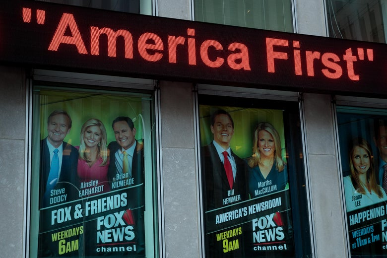 Advertisements for Fox News shows are displayed outside of the Fox News studio, Feb. 17, 2017 in New York City.