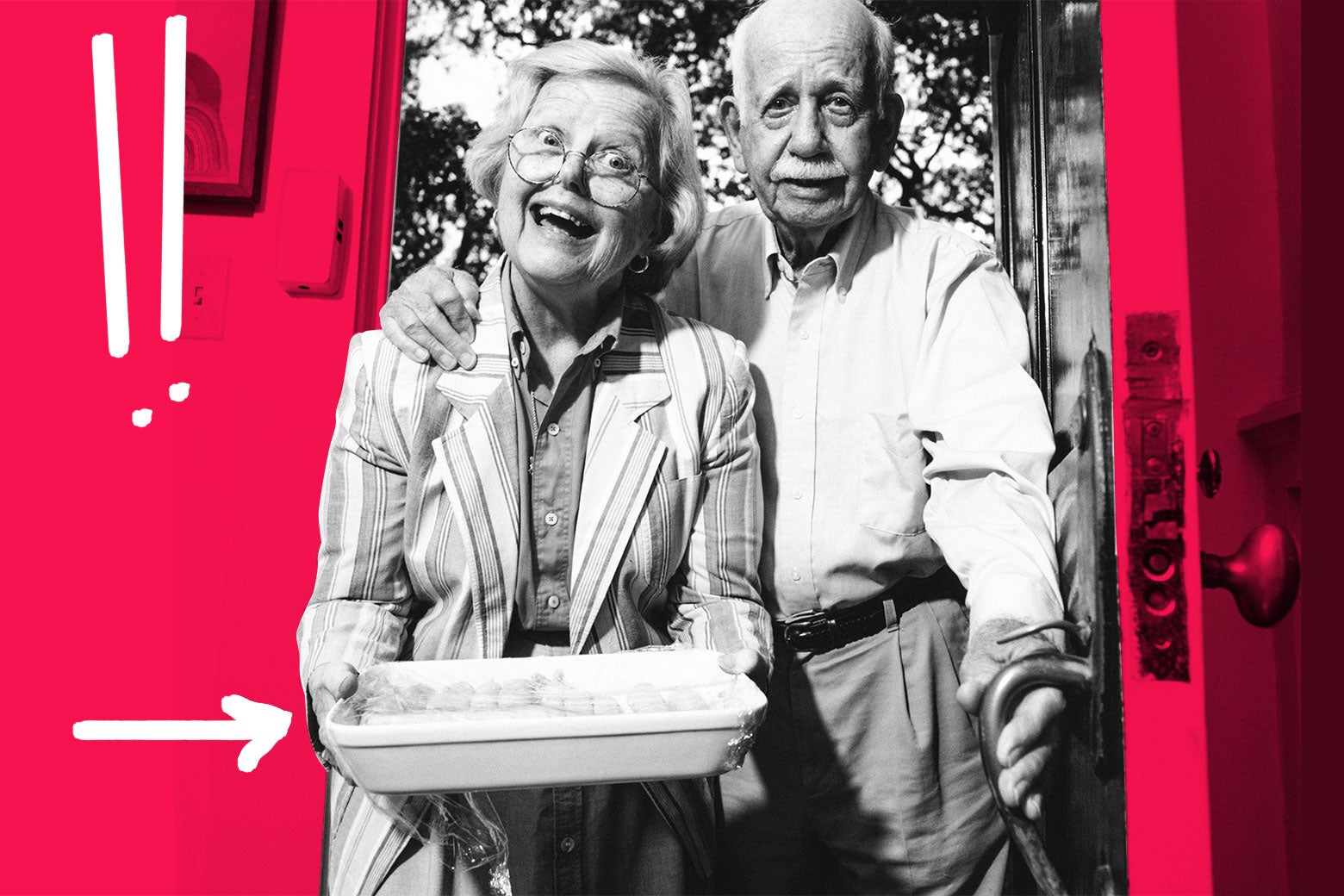 An elderly woman and man at the door with a casserole.